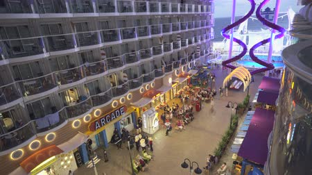 cabins : Promenade deck in a cruise ship. Balcony and boardwalk - Harmony of the Seas