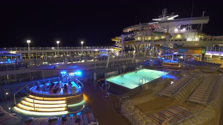 hotpot : Illuminated cruise ship pool deck at night - Harmony of the Seas Stock Footage
