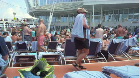személyszállító hajó : Crowd of people in a cruise ship pool deck - Harmony of the Seas, Caribbean sea