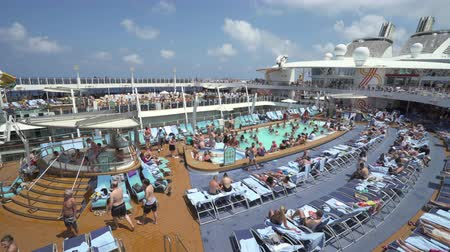suntan : Crowd of people in a cruise ship pool deck - Harmony of the Seas, Caribbean sea