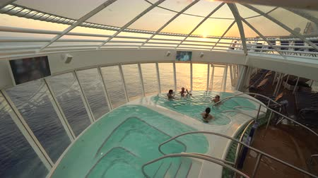 hotpot : Ocean view jacuzzi or hotpot at the cruise ship at sunset - Harmony of the Seas