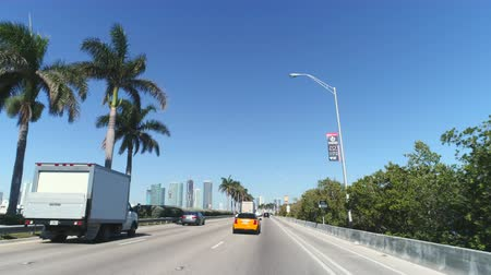 road sign : Driving through Miami traffic. Pov driving on the Miami streets, roads - March 2018: Miami, Florida, US Stock Footage