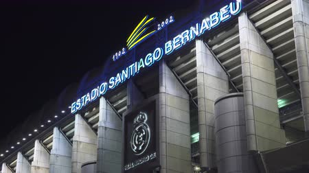 real madrid : Home of the Real Madrid soccer club. Santiago Bernabeu stadium at night - April 2018: Madrid, Spain Stock Footage
