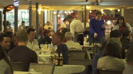 congested : Tourists have dinner at a restaurant on the Plaza Mayor, Madrid downtown, Spain