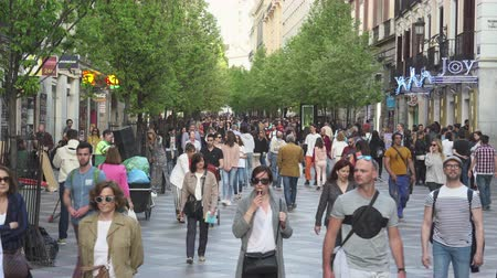 congested : Pedestrians on Calle de Arenal shopping street. Busy street in central Madrid Stock Footage