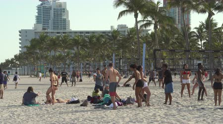 beach volleyball : Miami beach cityscape. Volleyball in south beach at spring break time. Stock Footage