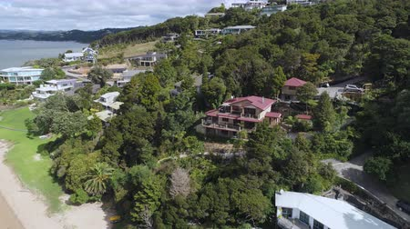 banliyö : Aerial of seafront houses, apartments - New Zealand, Bay of Island Stok Video