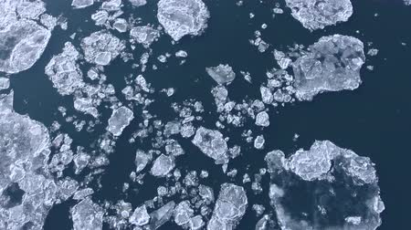 climate : Flight over of of ice floes, drifting ice, glacial sea