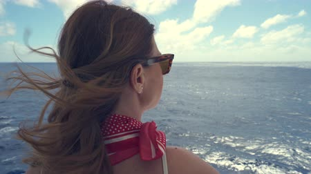 бортовой : Woman look out on balcony of cruise ship. View from behind