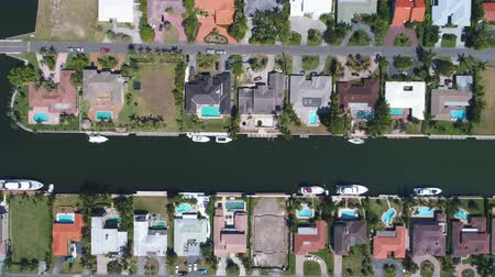 drone miami : Aerial shot of houses in a residential area. Suburbs of North Miami, Florida Stock Footage
