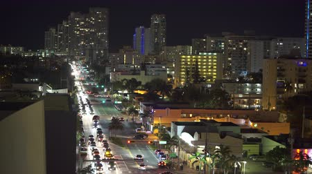 пригородный : Aerial shot of Miami cityscape and traffic at night - Miami Beach