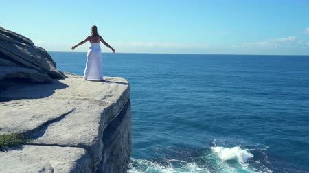 еж : Woman meditating on a cliff over the ocean, Yoga on the rock