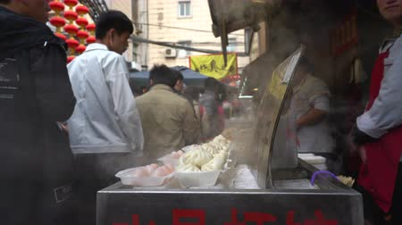 peking : Chinese street food vendor in Wangfujing snack street - Beijing, China - March 2017: Beijing, China