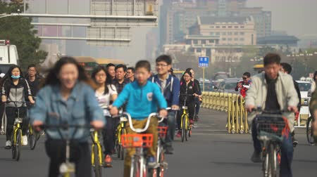 csomópont : Crowd of cyclist in Beijing, China. Chaotic, crowded street scene - March 2017: Beijing, China