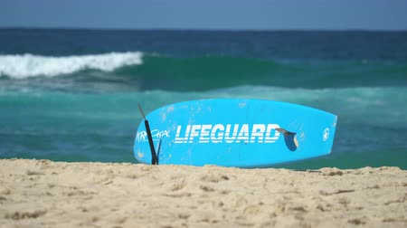 many surfers : Beach landscape. Lifeguard surfboard on the beach - March 2017: Australia