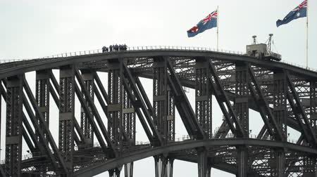 australian landscape : Climbing people at the top of Harbor Bridge, Sydney