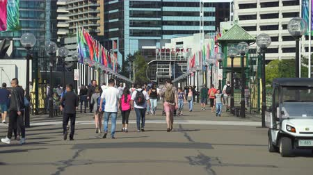 darling : Sydney downtown. Pedestrians on Pyrmont Bridge in Darling Harbor - March 2017: Sydney, Australia