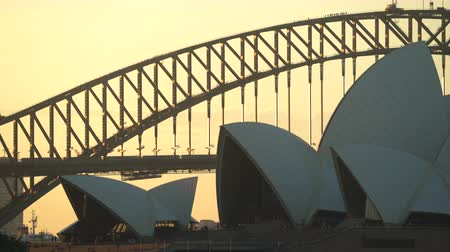 alkony : Stunning view of Sydney Opera House and Harbor bridge at sunset - March 2017: Sydney, Australia