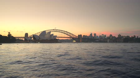 kirribilli : Sydney cityscape at sunset. Harbor Bridge and Opera house - March 2017: Sydney, Australia