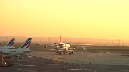 takeoff area : Airport runway at sunset. Plane takeoff - Char de gaulle, Paris