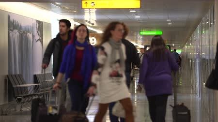 gangway : Lot of people walking in the airport terminal passageway - Heathrow, London