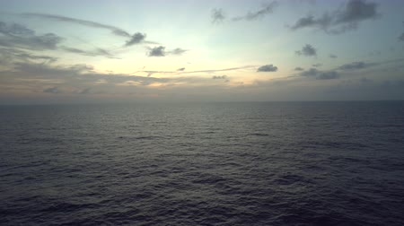 tracking : Aerial shot of open sea at sunset