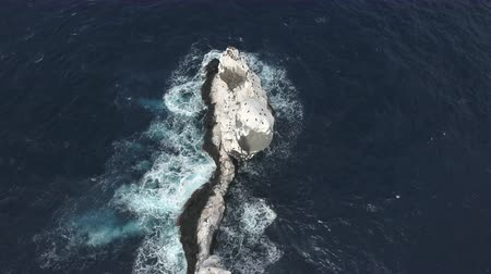 crashed : Fly over of oceanic rock, cliff, reef - washing up Roca Partida
