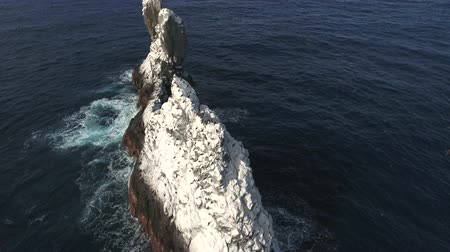 crashed : Aerial shot of ocean waves crashing spiky rock, cliff, reef - Roca Partida