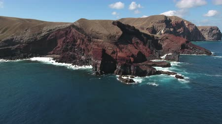 espetacular : Aerial shot of volcanic cliff, steep rocky coastline - San Benedict Island Stock Footage