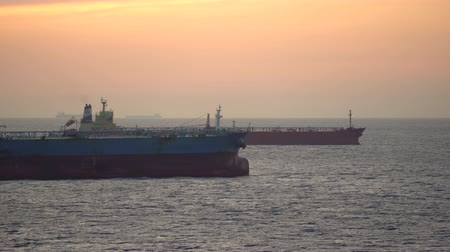 ancorado : Tanker or cargo ships silhouette at sunset