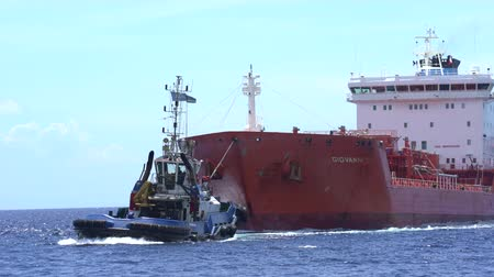 curacao : Tanker cargo ship and tugboat at sea