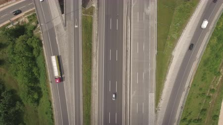 расширение : Flight over the motorway, freeway traffic - trucks and cars on the road