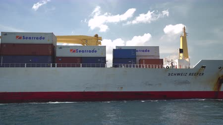 curacao : Big container cargo ship arriving in a port - Willemstad, Curacao