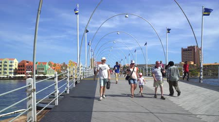 curacao : People walking on floating bridge - Willemstad downtown, Curacao