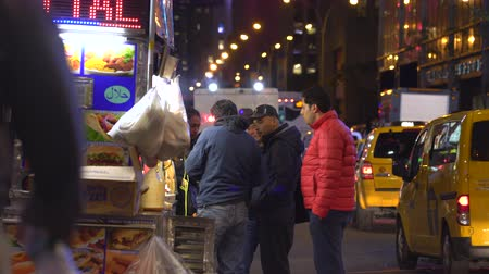 market vendor : New York City hot dog stand, street food car at night - Manhattan