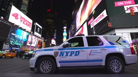 counterterrorism : New York City police car at the Time Square at night - Manhattan street scene Stock Footage