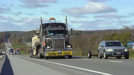 расширение : Trucks and cars on the road. Traffic on freeway - Pennsylvania, United States