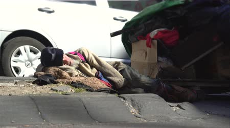 trousers : Homeless people lying on the street - Mexico City, Mexico