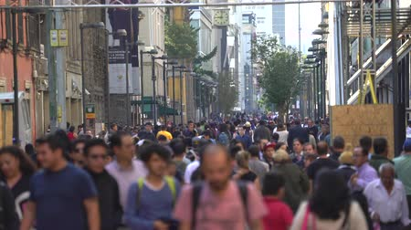 largest city : Mexico City street scene. Crowd of people walking in downtown