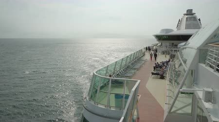 бортовой : Cruise ship sailing at sea - open deck and starboard side view