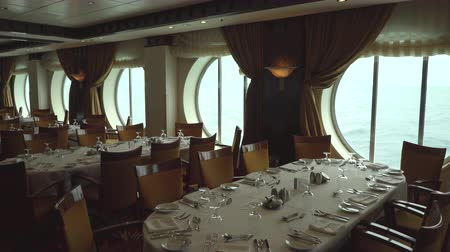 бортовой : Laid tables in a elegant and stylish restaurant - dining room in the cruise ship