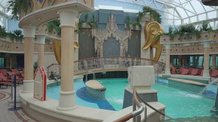 serenade : Cruise liner swimming pools and relaxing area- Serenade of the seas