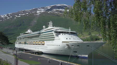 serenade : Cruise ship docked in port of Geiranger fjord - Norway