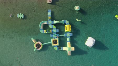 inflável : Aerial view of inflated water park on the sea, aqua park