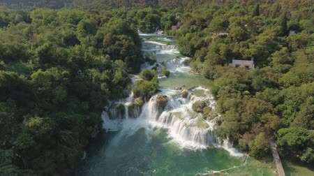 еж : Aerial view of waterfall in a canyon - Krka waterfall, Skradinski buk, Croatia Стоковые видеозаписи
