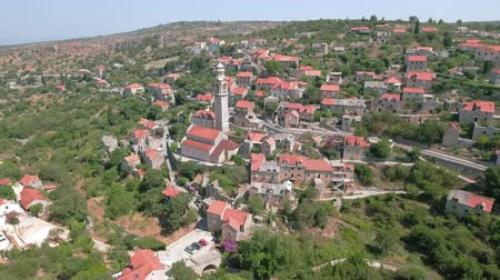 torre sineira : Aerial view of a cozy mediterranean village between the mountains - Lozisca, Cro Stock Footage
