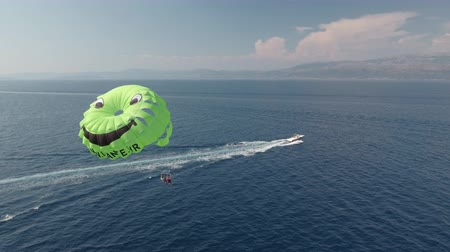 jet ski : Aerial shot of parasailing Stock Footage