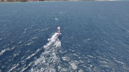 ježek : Aerial view of surfer windsurfing on the sea