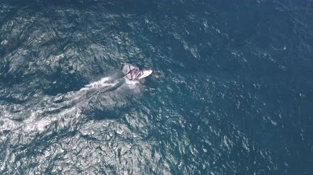 еж : Aerial view of surfer windsurfing on the sea