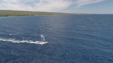 kirpi : Aerial shot of surfer windsurfing on the sea